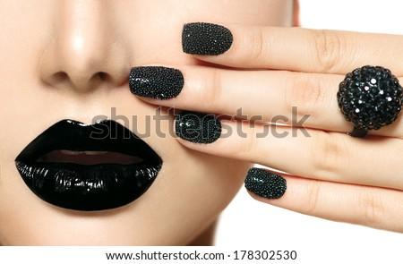 Beauty Black Caviar Manicure and Black Lips. Fashion Makeup and Manicure. Dark lipstick. Nail Art. Black ring accessories - stock photo