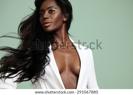 beauty black woman with a blowing hair - stock photo
