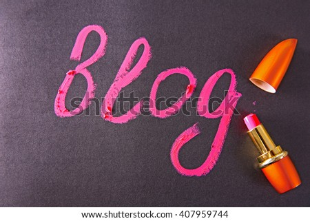 Beauty blog concept. Word Blog written in lipstick.