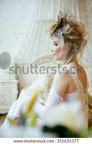 beauty blond emotional bride in luxury white vintage interiors extra ordinary hairstyle