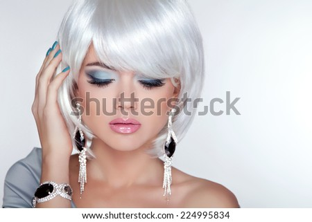 Beauty blond girl model with fashion earrings and White Short Hair. Bob hairstyle. Jewelry. Professional makeup  - stock photo
