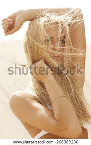Beauty Blond Girl With Long Healthy Blowing Hair  Extensions - stock photo