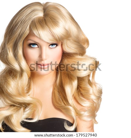 Beauty Blonde Woman Portrait. Beautiful model girl with long curly blond hair. Hairdressing, hairstyle. Healthy Long Wavy Hair. White Hair. Sexy Model. Blue eyes Make up. Hair Extensions  - stock photo