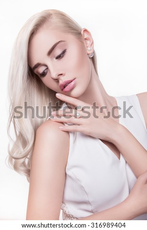 Beauty Blonde Woman Portrait.Beautiful model girl with long curly blond hair.Hairdressing, hairstyle.Healthy Long Wavy Hair.White Hair.White hair.Perfect Skin and Make up.MAKEUP.Beautiful female face - stock photo