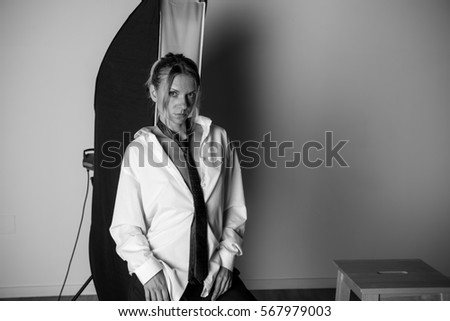 Beauty blonde woman posing in studio