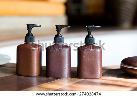 beauty, body care, luxury and hygiene concept - close up of liquid soap or body lotion set at hotel bathroom - stock photo