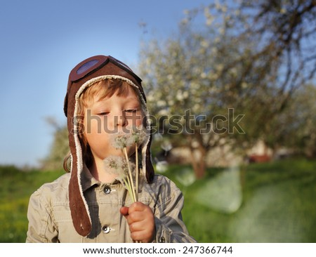 beauty boy with dandelion blowing - stock photo