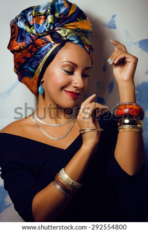 beauty bright african american woman with creative make up, shawl on head like cubian closeup - stock photo