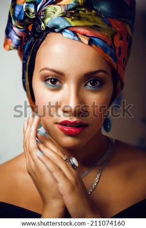 beauty bright african woman with creative make up, shawl on head like cubian woman closeup - stock photo