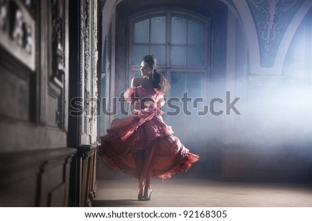Beauty brunette in gorgeous dress - stock photo