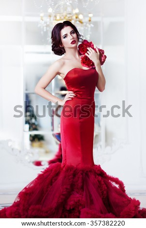 Beauty Brunette model woman in  evening red dress. Beautiful fashion luxury makeup and hairstyle,   full length - stock photo