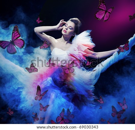 Beauty brunette on the fog with butterflies - stock photo