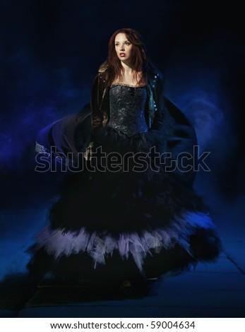 Beauty brunette wearing gorgeous dress - stock photo
