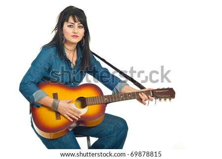 Beauty brunette woman sitting on chair and playing acoustic guitar ,copy space for text message in right part of image,isolated on white background