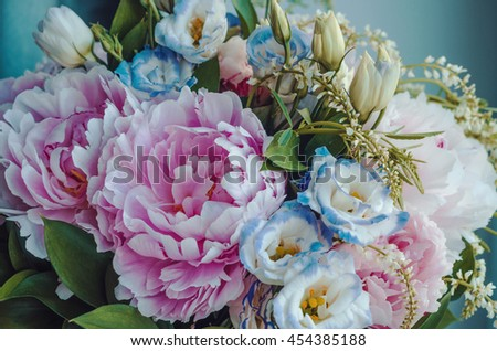 Beauty bunch of pink peonies peony and blue eustoma roses flowers, green leaf on background. Spring or summer lovely bouquet. Bloom love concept. Card, text place, copy space. Wallpaper, trendy color - stock photo