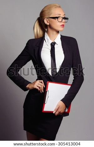 beauty business woman in glasses.beautiful girl in formal wear.accountant with a folder - stock photo