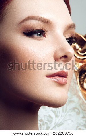 Beauty close-up portrait of young women with gray eyes, pink lipstick, smoky eyes on white background - stock photo