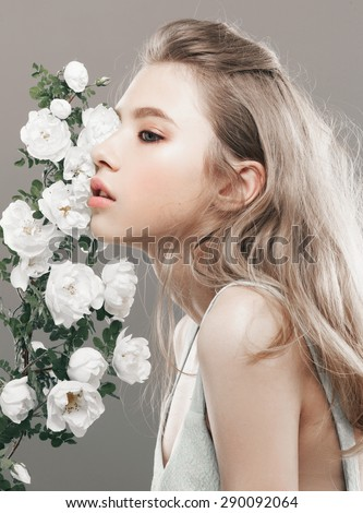 beauty close-up portrait young woman face with flowers - stock photo
