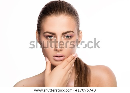 Beauty closeup portrait of young attractive woman with delicate makeup. Studio shot. White background.