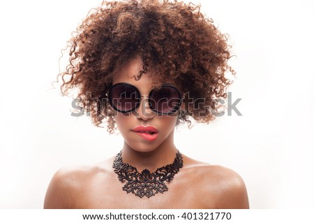 Beauty closeup portrait of young stylish african american girl with afro. Girl wearing fashionable sunglasses and necklace. - stock photo