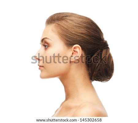 beauty concept - face of woman with beautiful hairstyle - stock photo
