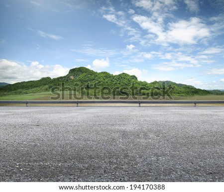 beauty Country Road Side View and mountain background - stock photo