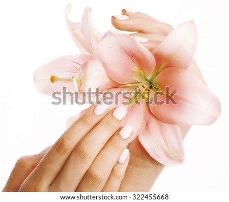 beauty delicate hands with manicure holding flower lily close up isolated on white perfect shape tender - stock photo