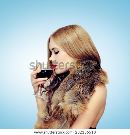 Beauty, drinks and people concept - profile sensual elegant woman enjoying the taste of wine - stock photo