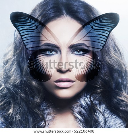 Beauty effect concept. Young and healthy woman with a butterfly wings on her face.  Plastic surgery, medicine, cosmetics, face lifting concept.