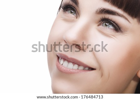 Beauty Face Closeup Of Young Caucasian Smiling Brunette Girl. Horizontal Image. Isolated Over White