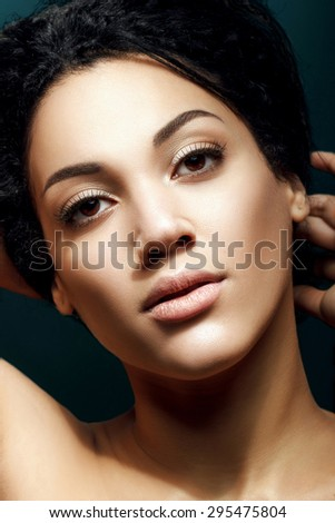 Beauty face closeup portrait. Attractive mixed race African/ Caucasian model with perfect skin. Skincare and wellness.  - stock photo