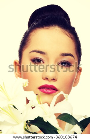 Beauty face of a woman with flower. - stock photo