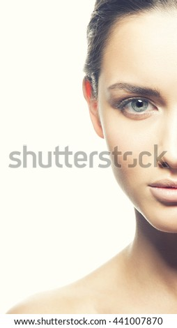 Beauty face of caucasian young brunette woman. Studio portrait. Isolated on white background. Toned - stock photo
