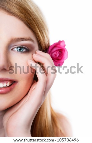 Beauty face of the young beautiful girl with flower. Girl on white background