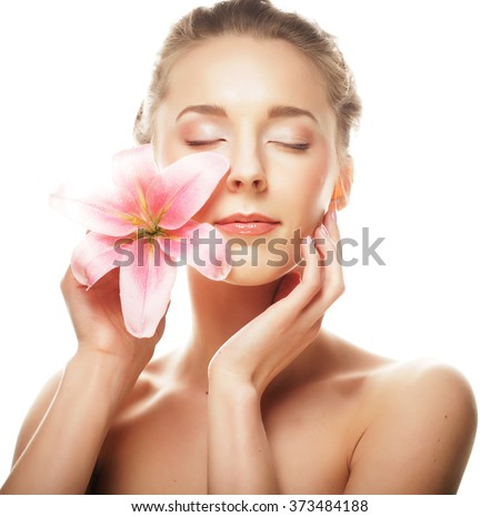 Beauty face of the young woman with pink lily  - stock photo