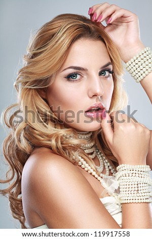 beauty face of young beautiful woman with health clean skin in pearl necklaces - stock photo