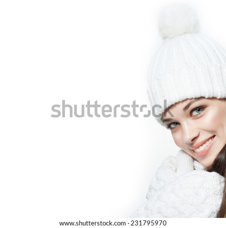beauty face portrait of attractive young caucasian woman in warm clothing  studio shot isolated on white toothy smiling winter - stock photo