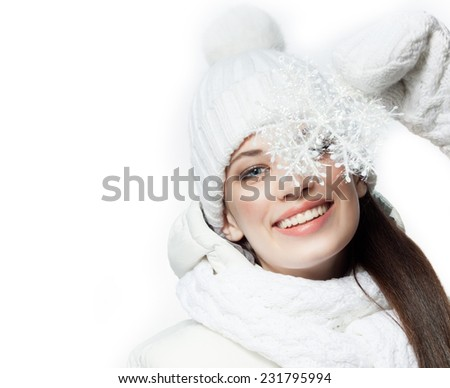 beauty face portrait of attractive young caucasian woman in warm clothing  studio shot isolated on white toothy smiling winter snowflake - stock photo