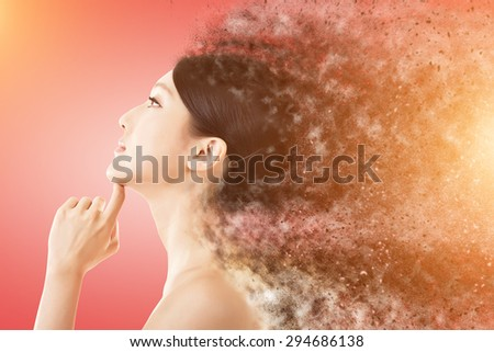 Beauty face with sand storm effect, concept of beauty, cosmetic, women etc. - stock photo