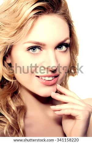 Beauty face woman. Female healthy model in spa salon. Cream treatment products. Facial skin therapy.  Beautiful smile, teeth. Dental - stock photo