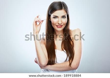 Beauty face young woman with skin care cream. Studio isolated. - stock photo