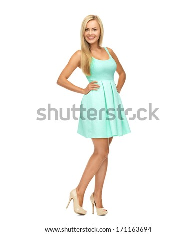 beauty, fashion and happy people concept - young woman in yellow dress and high heels - stock photo