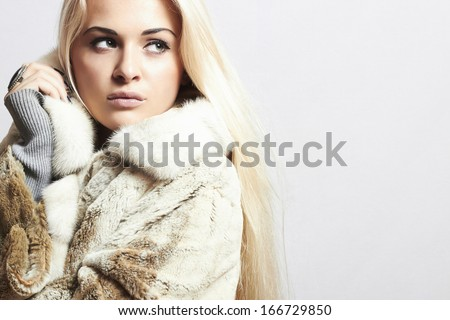 Beauty Fashion blond Model Girl in Mink Fur Coat. Beautiful Woman in Luxury Fur Jacket . Winter Fashion. your text here - stock photo