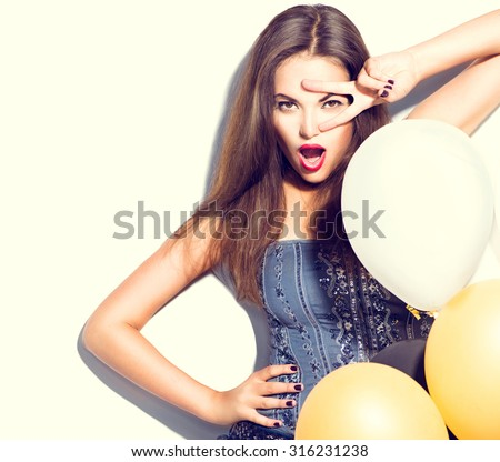 Beauty fashion brunette model girl with colorful balloons posing isolated on white background. Fashion model girl making v-sign or victory gesture. Perfect make up and manicure. Party celebration - stock photo