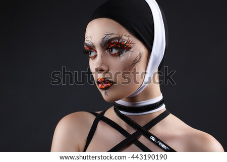 Beauty fashion close-up portrait. Girl with bright creative professional make-up. Beautiful blue eyes, black and white accessories - stock photo