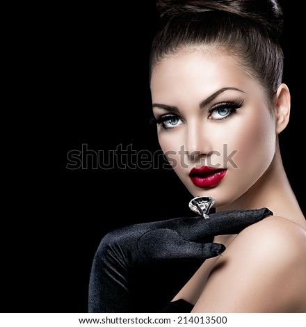 Beauty Fashion Glamour Girl Portrait over black background. Vintage Style Girl Wearing Gloves. Jewellery. Jewelry. Glamor Hairstyle and Make-up. Sexy Red Lips. Diamond Ring. Retro Woman Portrait  - stock photo