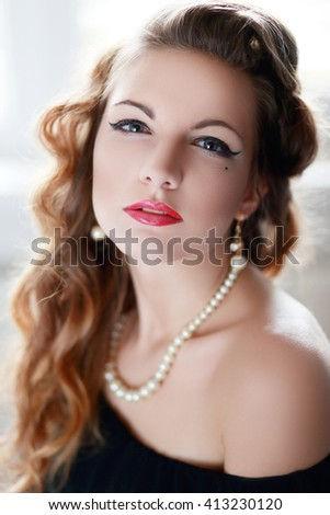 Beauty Fashion Glamour Girl Portrait. Vintage Style Girl Wearing Gloves. Jewellery. Jewelry. Glamor Hairstyle and Make-up. Diamond Ring. Retro Woman Portrait - stock photo
