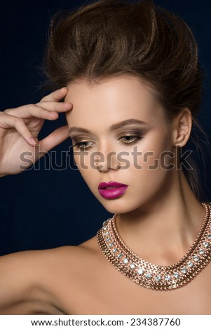 Beauty fashion glamour woman portrait over dark blue background. Glamor hairstyle and make-up. - stock photo
