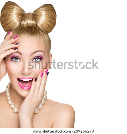 Beauty fashion happy surprised model girl with funny bow hairstyle, pink nail art and makeup isolated on white background. Laughing retro styled young woman. Emotions - stock photo