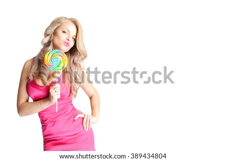 Beauty fashion model girl Eating colourful lollipop. Lollypop.
